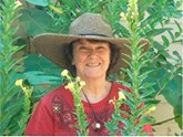 Gayle Engels standing among mullein stalks